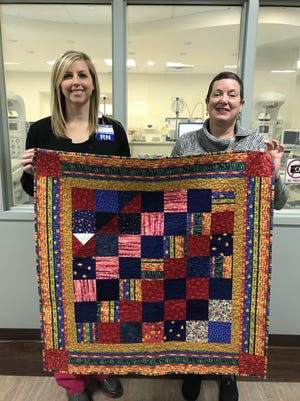 The Hill 'N Hollow Quilters recently donated 23 baby quilts to the Women and Newborn Care Center at Baxter Regional Medical Center. Accepting the quilts was Rachel Farris, Director of Obstetrics and the Women's Center. She is show along with Sandra Allenbaugh,Chair of Community Quilts. The nursery was very appreciative and plans to place an article in the hospital newsletter, according to a news release.