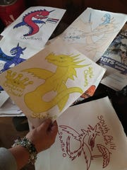 Lisa Stagliano shows her son Santino's dragon drawings he created for Philadelphia Mummers Fancy Brigades.