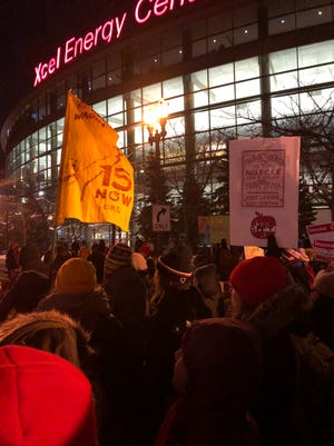 A group of protesters demonstrated outside Super Bowl Opening Night.