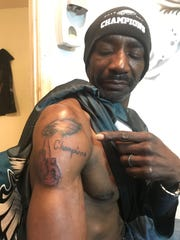 "Clarence ""Sonny Bono"" Taylor's tattoo represents his two loves: the Eagles and boxing."