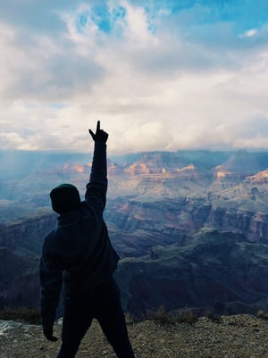 """Rubén J. Carbajal, @rubenjcarbajal on Twitter, posted a photo of himself silhouetted against the canyon in the now-iconic """"Hamilton"""" fist-in-the-air pose."""