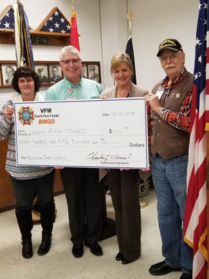 The Ozark VFW Post 3246 recently donated $750 to Hospice of the Ozarks in memory of Ray Loop and Charles Wensel Sr. Pictured are: (from left) Opal Wensel,VFW Ozark Post # 3246 Bingo Chair;Greg Wood, Hopsice of the Ozarks Executive Director;Elaine Essary, Outreach & Development Coordinator at Hospice of the Ozarks; and Charles Wensel,VFW Ozark Post # 3246 Bingo Chair.