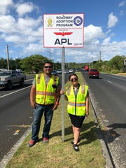 APL Guam partnered up with the Lieutenant Governor's Office and the Island Beautification Task Force to adopt a roadway and several bus stops in an effort to give back to the community and our children. Pictured: Charles Emsley, area logistics assistant, Severina Koss, administrative assistant.