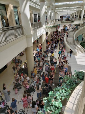 "Shoppers pack the Poughkeepsie Galleria on July 12, 2018, for a one day ""Pay Your Age"" sale at the Build-a-Bear Workshop."