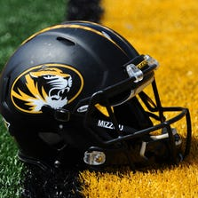 A Missouri Tigers football helmet is seen on the field during the Black & Gold Game at Faurot Field.