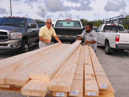 Tibor Menyhart and Kaiton Polkeim load Menyhar's truck with plywood and 2x6's at the Home Depot on Merritt Island. Brevard residents started prepping for Irma and stores got busy with shoppers looking for plywood, gas and water.
