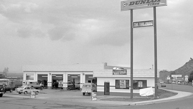 """In June of 1988 when the then image was taken by Spectrum photographer Nancy Rhodes the Tire Pros store on the corner of Bluff Street and 300 North had just been remodeled. """"You can see the landscaping still isn't done, its got the old Dunlop sign out there ÐÊwe were kind of exclusive back then selling dunlop,"""" said the store's owner, Randy Holyoak. """"We bought the store in 1978 and when we first moved here, Bluff street was a two lane road. Now, in a couple years they're gonna make this a seven lane road.""""Holyoak said he tore the brick building down in the mid 1980s, and rebuilt and expanded the current store on the old foundation. The store was painted yellow and red  when the then image was taken. One of the more interesting things that can be seen int he background of the image is the flagpole standing in both the then image and the now image taken by Spectrum photographer Jud Burkett. The flagpole stood outside the St. George City Offices when they were located between 200 North and 300 North on Bluff Street prior to the construction of the city office building on 200 North and 200 East in 1980 according to St. George City Manager Gary Esplin. The flagpole appears to have had a plaque on it at some point but right now it stands unmarked."""