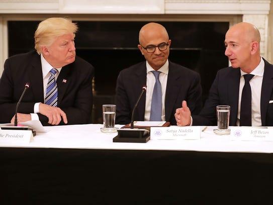 (L-R) U.S. President Donald Trump, Microsoft CEO Satya