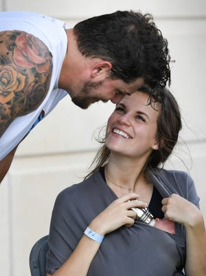 Titans tackle Taylor Lewan visits with his fiancee, Taylin Gallacher, and his infant daughter, Wynne Rebel, after training camp practice in July 2017.