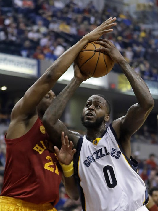 Memphis Grizzlies' JaMychal Green goes to the basket against Indiana Pacers' Thaddeus Young during the first half of an NBA basketball game Friday, Feb. 24, 2017, in Indianapolis. (AP Photo/Darron Cummings)