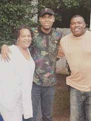 Treon McClendon (center) was raised by his mother, LaVenita McClendon (left) in Indianapolis. But he struggled with his relationship with his father, Robert Daniels (right), who lived in Georgia. This picture is from a rare reunion in 2017.