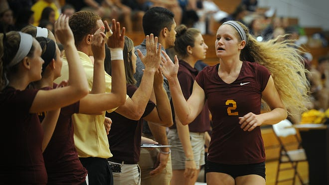 Katie Stouffer high-five's her teammates as she returns to the bench against McDaniel on Friday, Sept. 9, 2016 at Maggs Physical Activity Center.