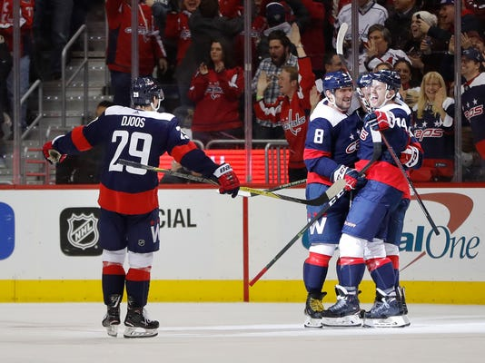 Washington Capitals defenseman John Carlson (74) celebrates his goal against the Dallas Stars with defenseman Christian Djoos (29), left wing Alex Ovechkin (8), and defenseman Jakub Jerabek during the third period of an NHL hockey game Tuesday, March 20, 2018, in Washington. The Capitals won 4-3. (AP Photo/Pablo Martinez Monsivais)