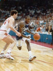 John Morton dribbles past an Indiana defender in the