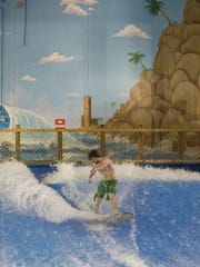 James O'Brian rides the FlowRider at Sahara Sam's Oasis in West Berlin in a 2009 file photo.