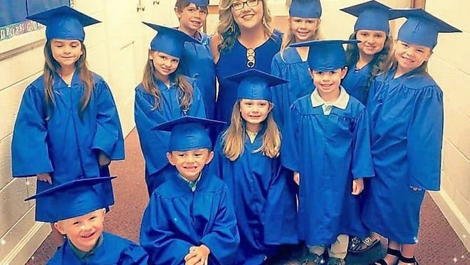 Fifteen preschool students graduated from The Creation Station on June 25. Ten of those students attended the event and are pictured here with director Tori Towne.