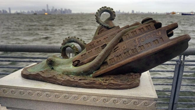 A cast bronze monument by artist Joseph Reginella, depicting a fake octopus attack on the steam ferry Cornelius G. Kolff, is shown Thursday in the Staten Island borough of New York.