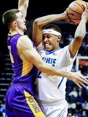 Memphis forward Jimario Rivers (right) drives the lane against Albany defender Joe Cremo (left) during first half action at the FedExForum on Tuesday in Memphis.
