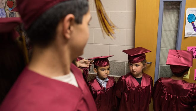 Kindergarten students at Tuloso-Midway Primary School look up at Tuloso-Midway High Schools' graduating class before the school's Walk of Inspiration on Thursday, May 18, 2017.