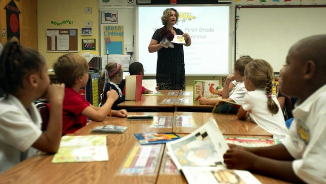 This file photo shows Karine Ruatta reading a book to first-grade French immersion students at Myrtle Place Elementary in August 2010. The University of Louisiana at Lafayette is seeking to add a new Master of Arts in Teaching degree with a concentration in elementary French immersion.