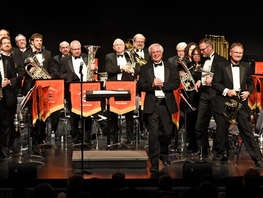 The Lake Wobegon Brass Band members receive applause