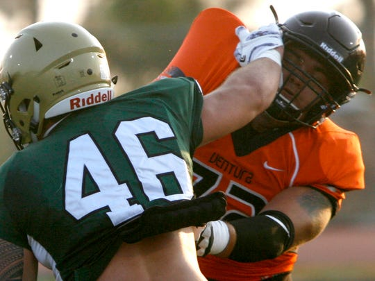 Ventura College offensive lineman Jake Colman (right) protects the line during a scrimmage against L.A. Valley College.