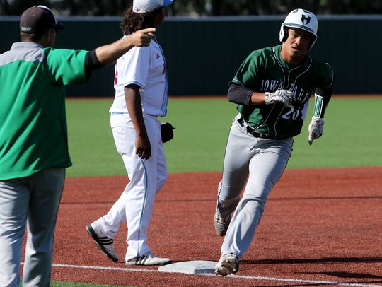 Iowa Park's Chris Dickens rounds third base in the
