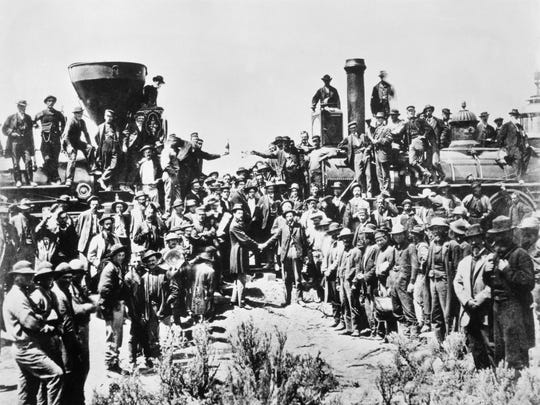 Trains meet to create the Transcontinental Railroad in  1869.