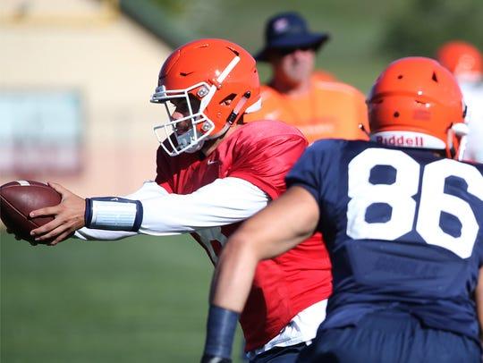 UTEP quarterback Zach Greenlee drills Friday at Camp