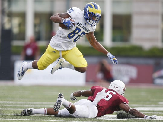 Delaware receiver Diante Cherry is tripped up by Lafayette's Phillip Parham in the first quarter of a 2016 game.