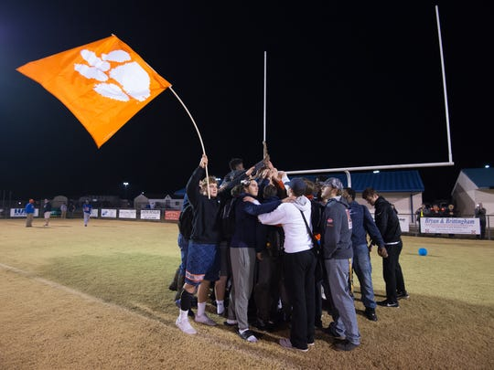 The Delmar High School football team celebrates on their home field after returning home from their 14-7 victory over Milford in the DIAA Division II championship game Saturday night at Delaware Stadium.