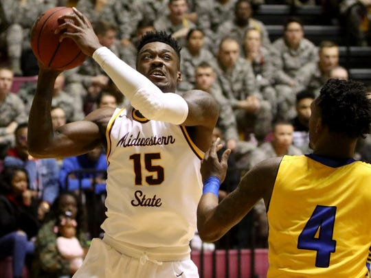 Midwestern State's Ola Ayodele goes for two against Angelo State Saturday, Feb. 3, 2018, in D.L. Ligon Coliseum at MSU. The Mustangs defeated the Rams 88-78.
