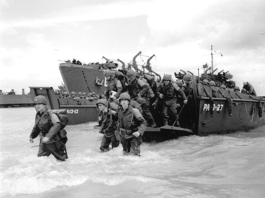 """American reinforcements in a Coast Guard barge land on the beaches of Normandy on D-Day, June 6, 1944. Among the troops who landed at Utah Beach that day was Selma native Ralph """"Shug"""" Jordan, who distinguished himself in battle and went on to became a legendary football coach at Auburn."""