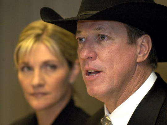 Jim Kelly, right, speaks to the media as his wife, Jill, listens during a news conference prior to the sixth annual Hunter's Hope Candlelight Ball in Buffalo, N.Y., on Nov. 18, 2005.