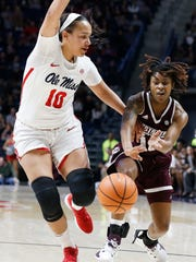 Mississippi State guard Jazzmun Holmes (10) passes past Mississippi forward/center Cecilia Muhate (10) during the first half of an NCAA college basketball game in Oxford, Miss., Sunday, Jan. 28, 2018. (AP Photo/Rogelio V. Solis)