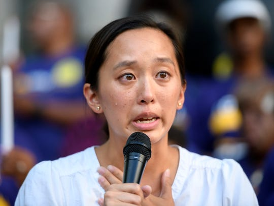 Michigan State Representative Stephanie Chang sheds a tear while speaking in support of the members of SEIU Local 1 Janitors a strike authorization announcement in front of One Campus Martius, in Detroit, July 23, 2018.  (David Guralnick / The Detroit News)