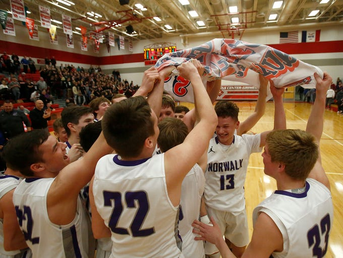 Norwalk players celebrate with their Class 3A state