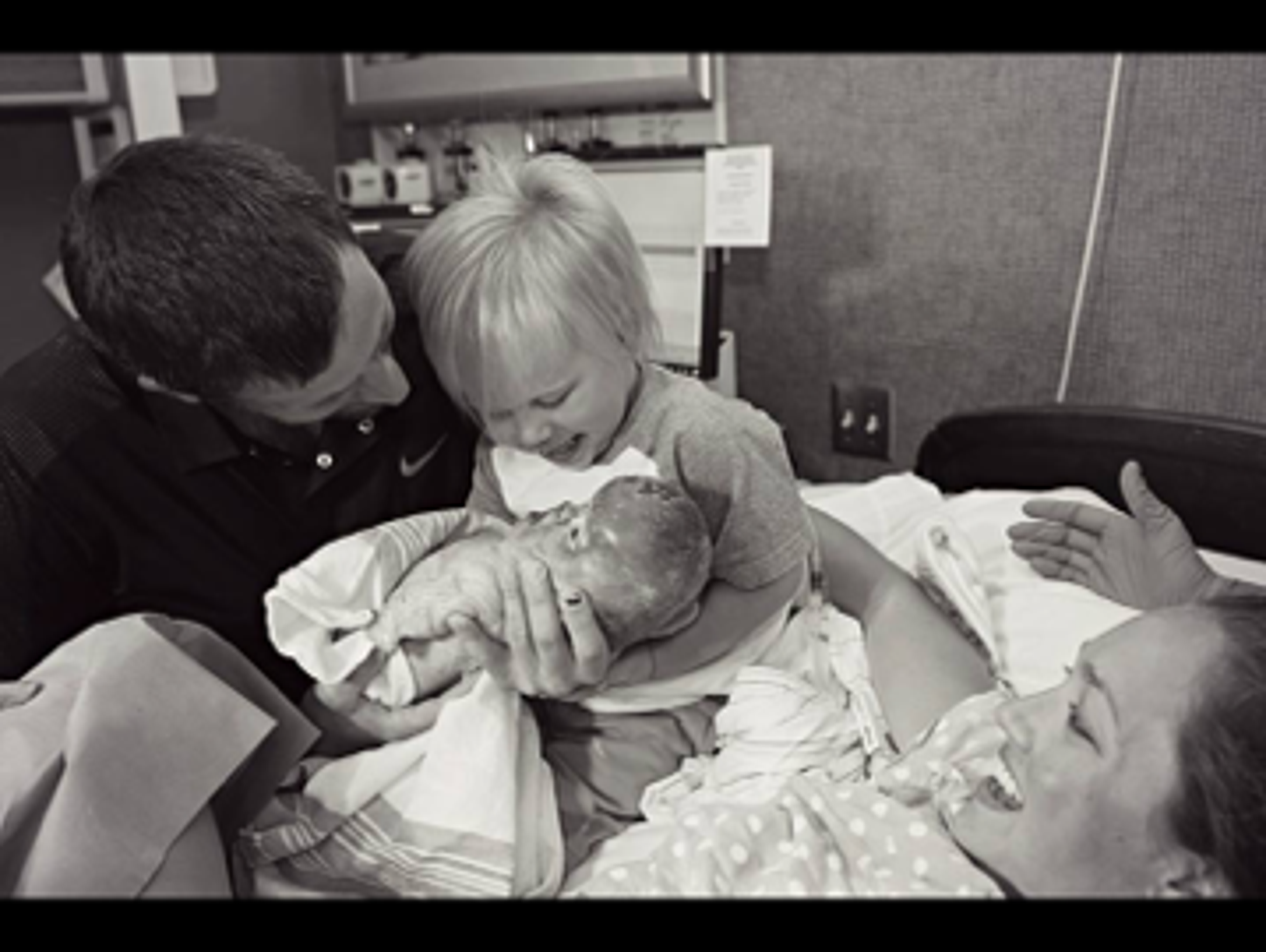 Talia and Josh introduce their son, Kye, to his baby