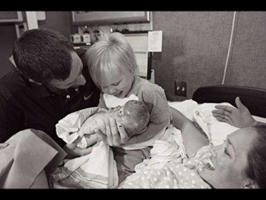 Talia and Josh introduce their son, Kye, to his baby sister, Aubrey.