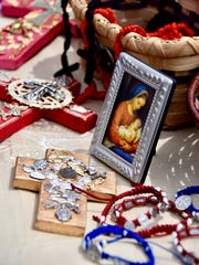 Religious objects, for sale at the Franciscan Art Festival, are seen in an artisan's booth. The festival continues today,