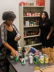 Student workers ShaiQuana Bailey, left, and Suharis