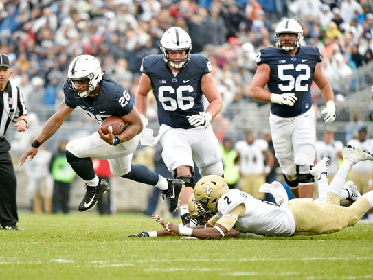 Penn State's Saquon Barkley leaps out of Akron's Shawn