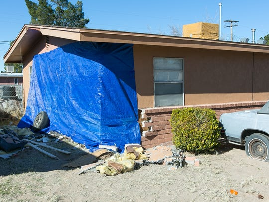 The side of  Bert Diaz and Sarah Garces' home on La