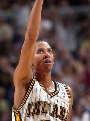 Pacers Reggie Miller celebrates hitting a last second three-pointer at the end of the second quarter of their game against Miami Saturday evening at Conseco Fielshouse.