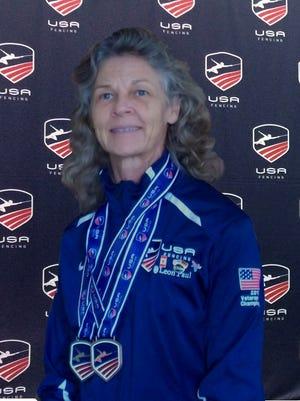 Georgina Love has been named Open Veteran Womens' Foil Gold Medalist.