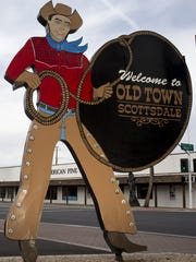The historic cowboy sign sits on the northeastern corner of Scottsdale Road and Main Street in Old Town Scottsdale. In 1952, the Scottsdale Area Chamber of Commerce installed the sign to direct people to its offices, welcome them to Old Town and list community events.