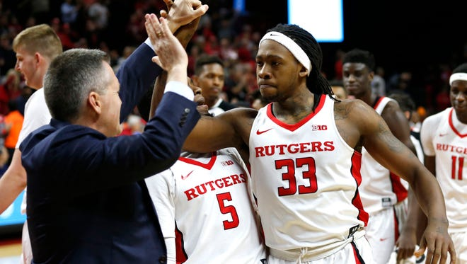 Rutgers Athletic director Pat Hobbs celebrates with Rutgers Scarlet Knights forward Deshawn Freeman (33) after the game-winning shot.