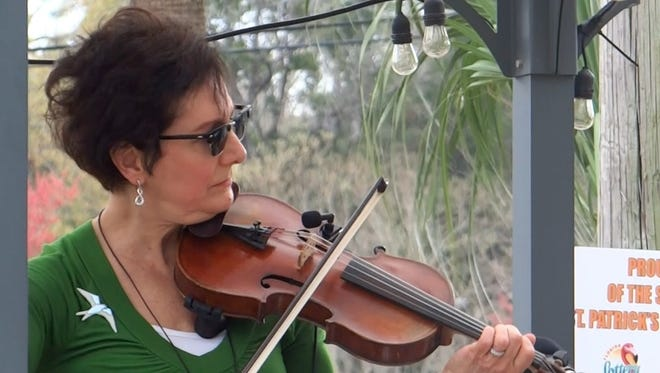 Marie Donnelly plays the fiddle in Roisin Mo Chroi, which was formed in 2004.