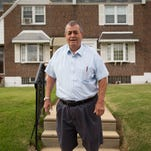 Myles Griffin, 74, stands in front of his home in Philadelphia. Griffin has lived with his wife for 40 years in their three-bedroom row home and after retiring three years ago, the couple signed up for a reverse mortgage in May.