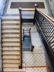 The stairway is lined with marble from Georgia and Italian tiles adorn the floors.